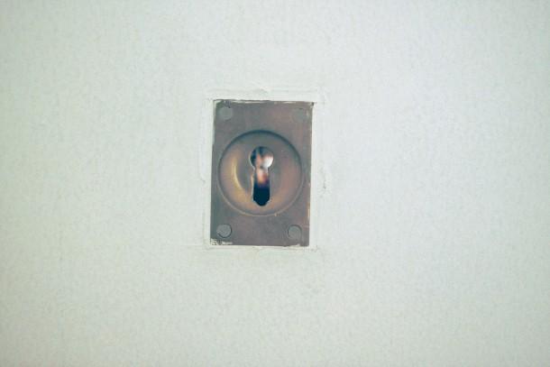 Key hole, slide showing derelict hospital Key hole, slide showing derelict hospital